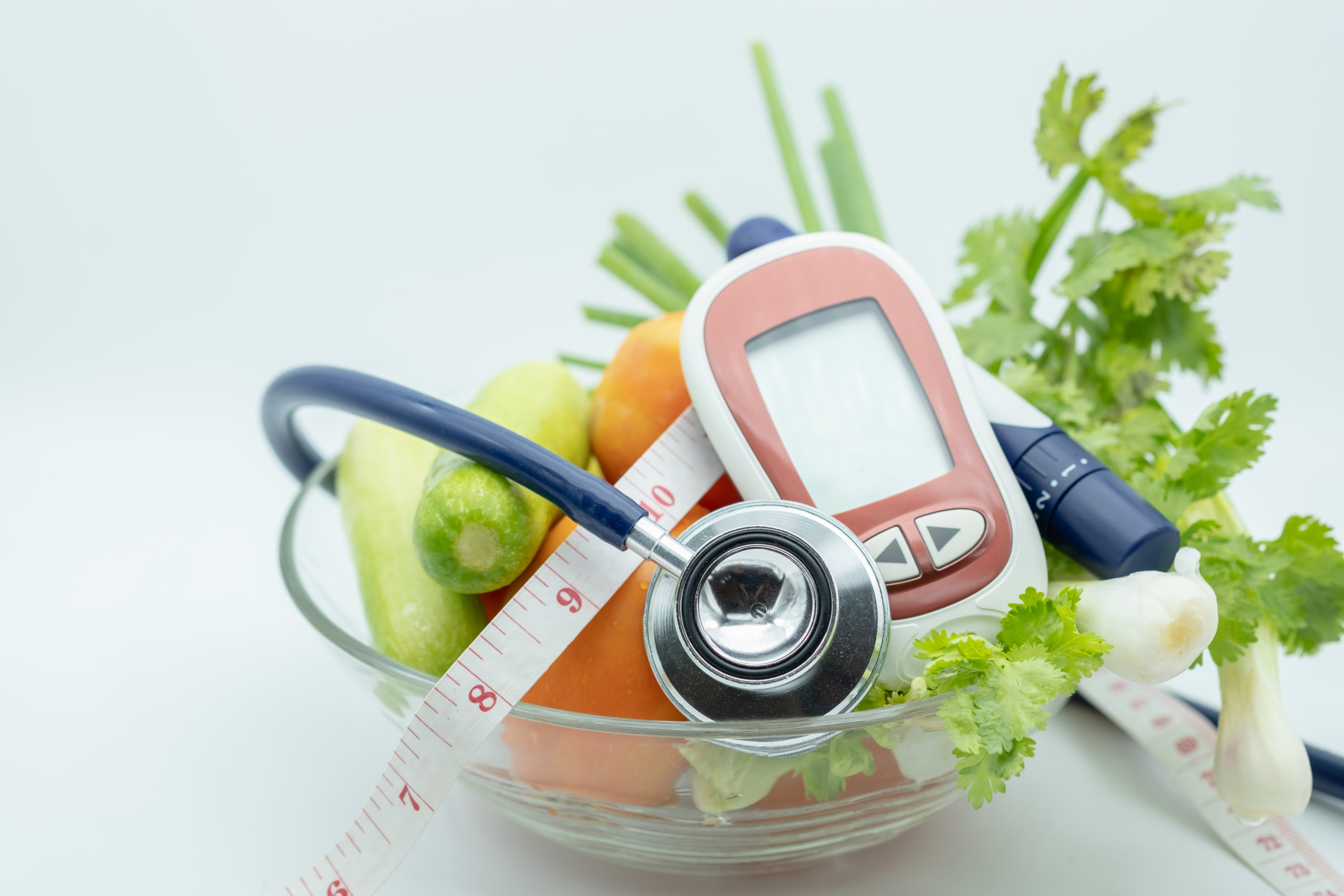fruits, vegetables, diabetes glucometer, and other items